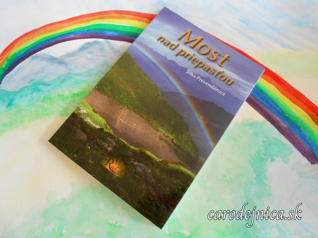 Kniha Most nad priepasťou položená na arteterapeutickom obrázku